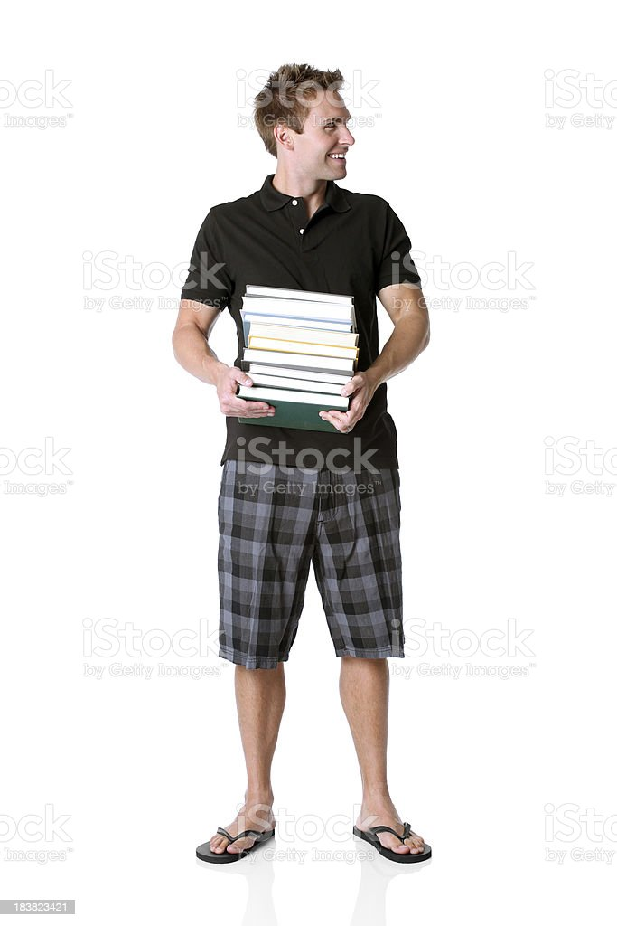 Man carrying a stack of books stock photo
