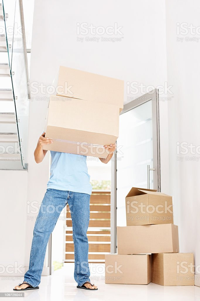 Man carrying boxes - moving to new home concept royalty-free stock photo