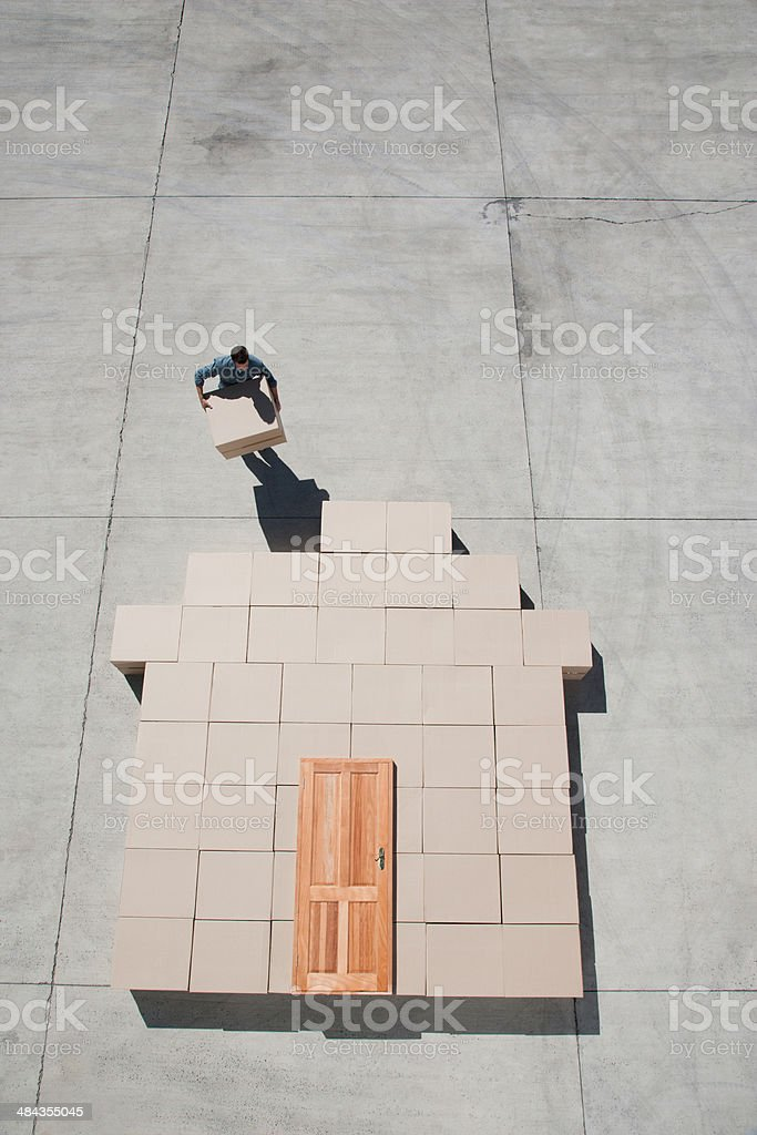 Man carrying boxes outdoors stock photo