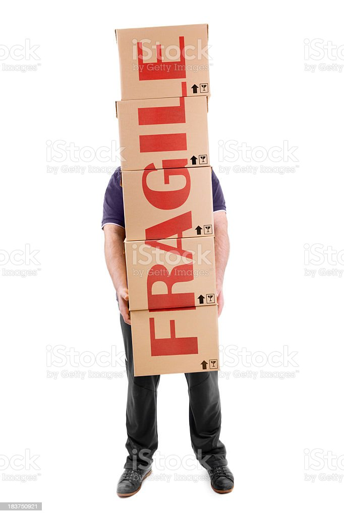 Man carrying boxes with a big fragile sign across them royalty-free stock photo