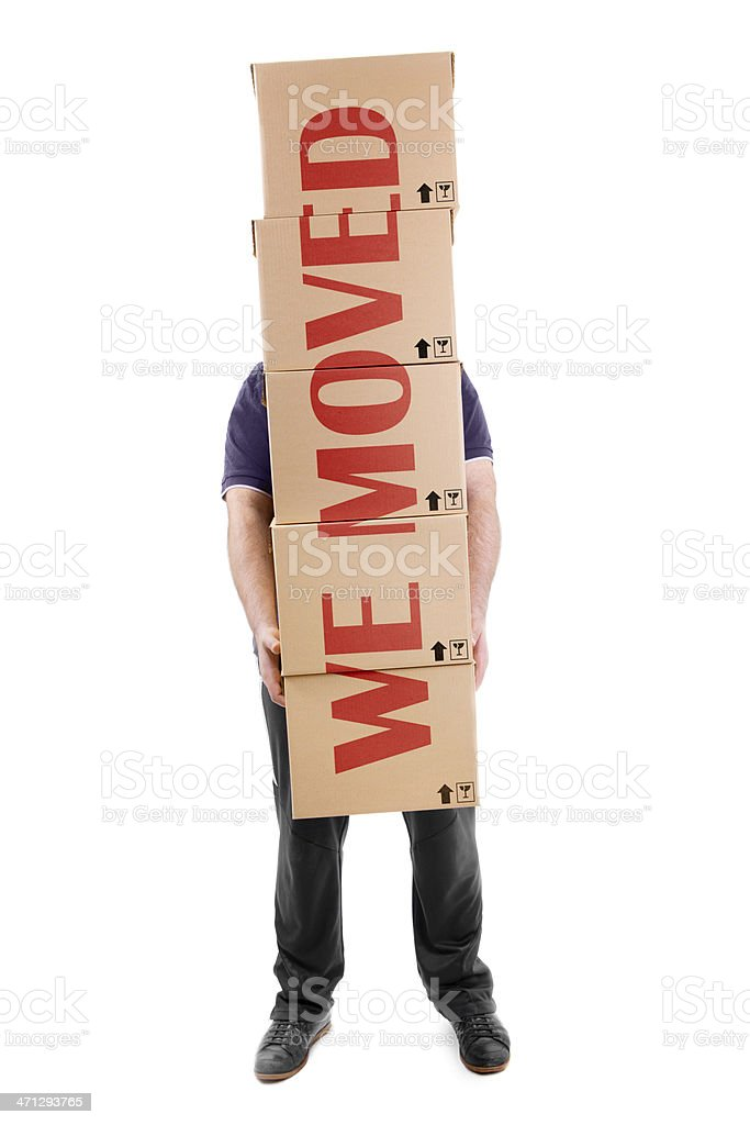 Man carrying boxes with a big  sign across them royalty-free stock photo