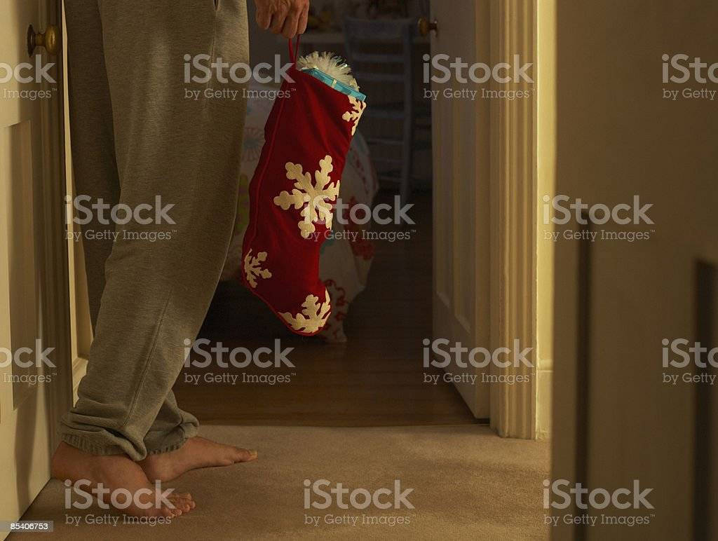 Man carrying Christmas stocking royalty-free stock photo
