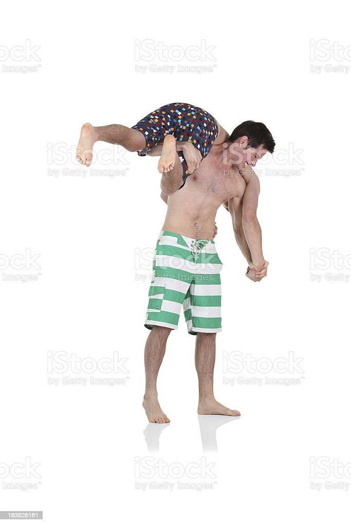 Man carrying his friend on shoulders royalty-free stock photo