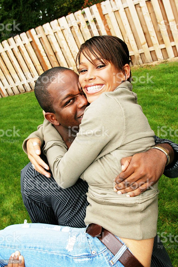 Man Carrying his Girlfriend Outside royalty-free stock photo