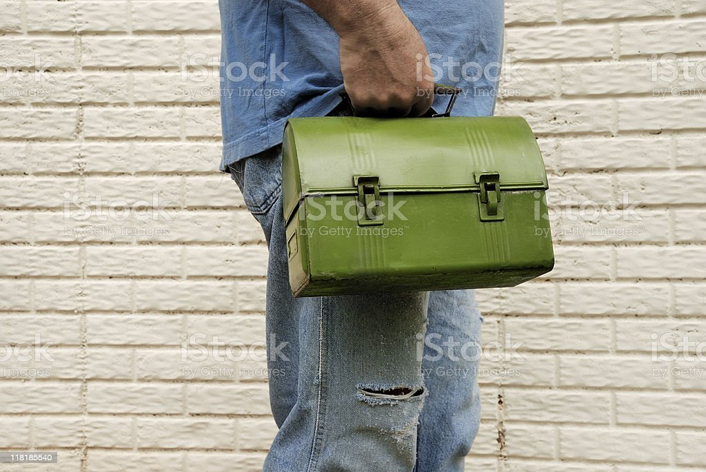 Man carrying lunch box to work. Manual laborer. royalty-free stock photo