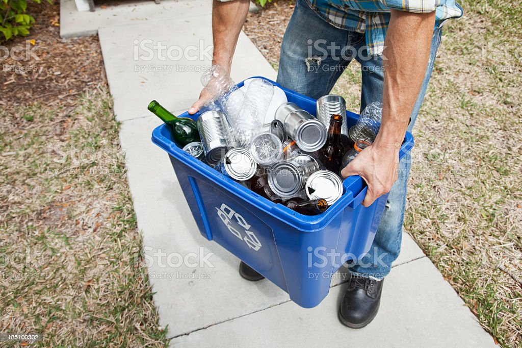 Man carrying recycle bin stock photo