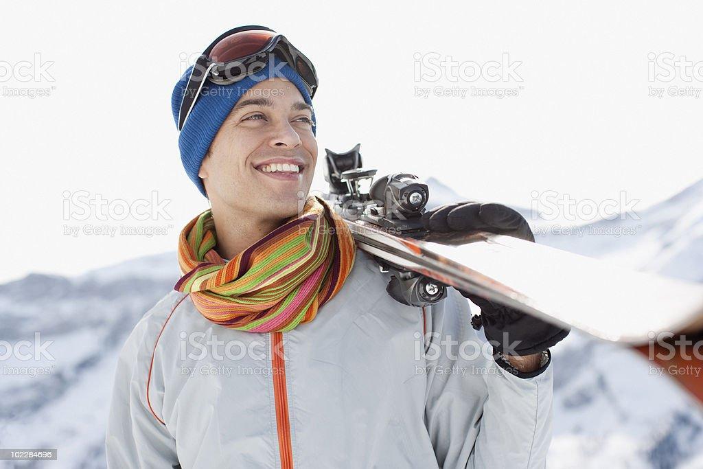Man carrying skis stock photo