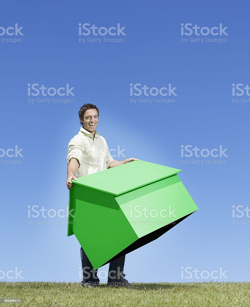 Man carrying small model house royalty-free stock photo