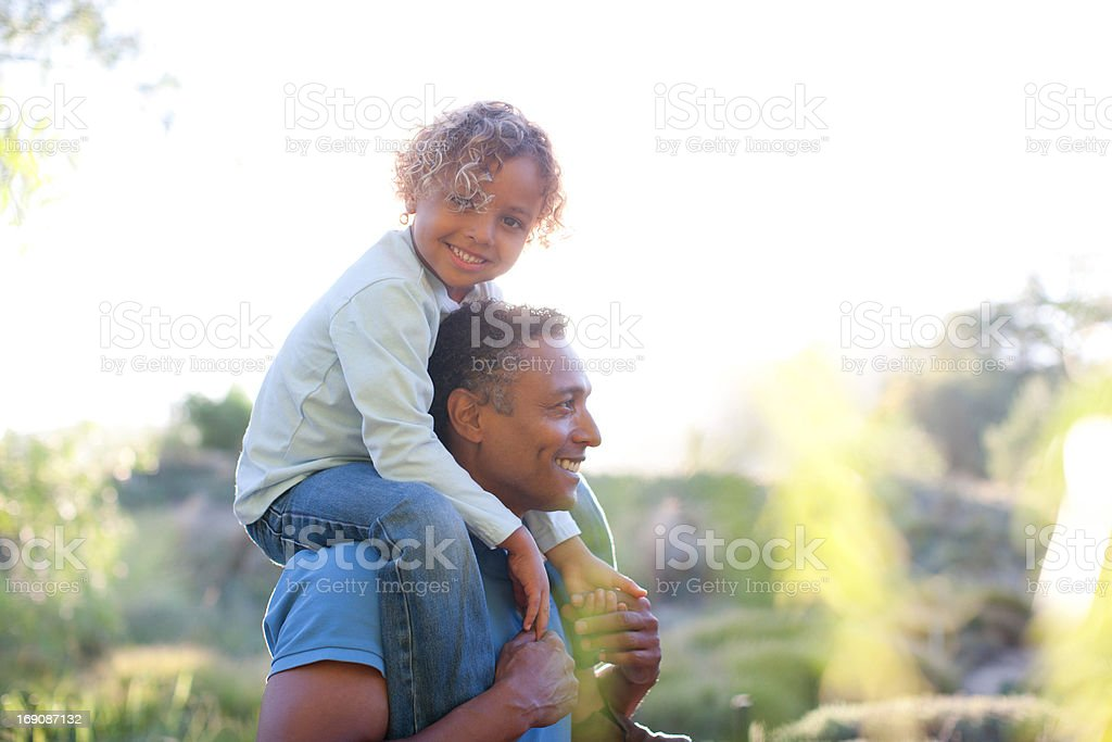 Man carrying son on shoulders royalty-free stock photo