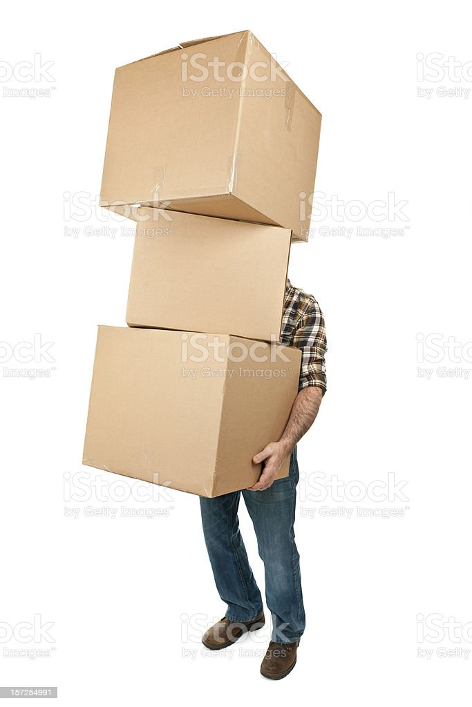 Man carrying stack of cardboard boxes stock photo