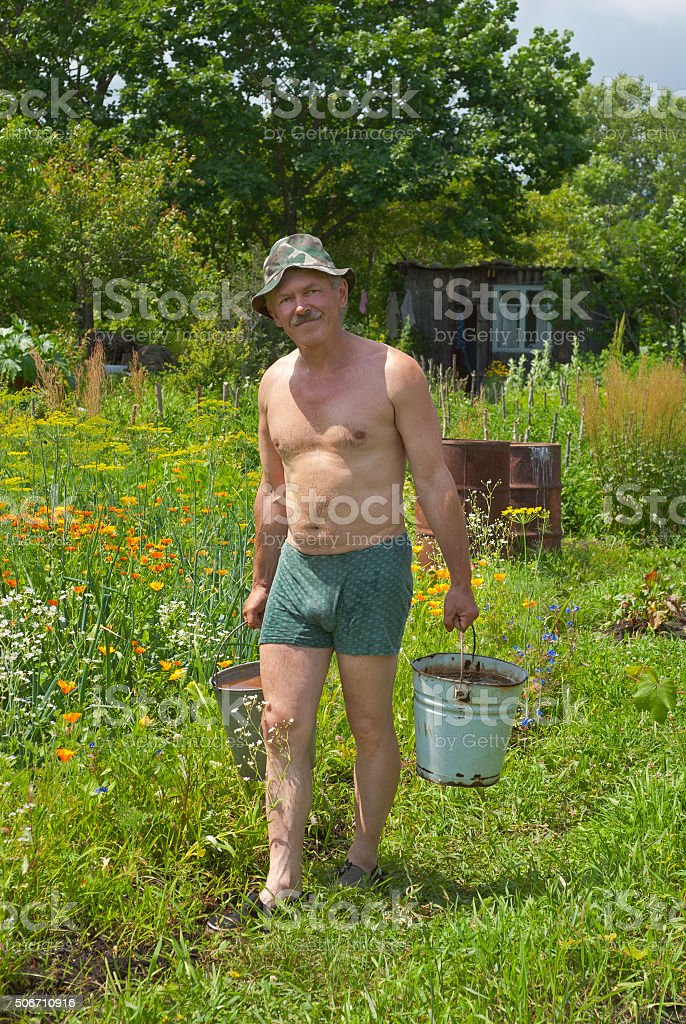 Man carrying water stock photo