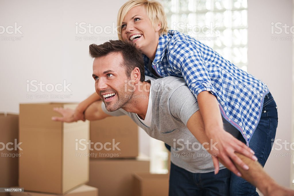 Man carrying wife on his back royalty-free stock photo