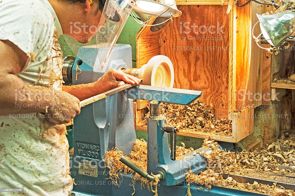Man Carving Bowl Mrytlewood Factory in Oregon stock photo