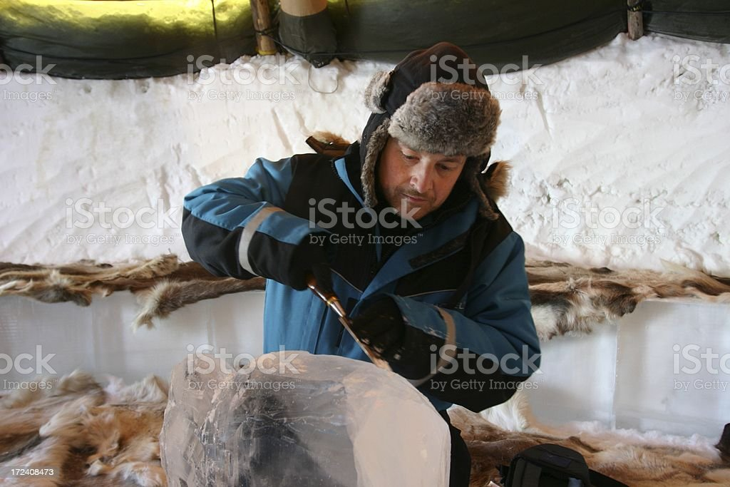 man carving ice stock photo