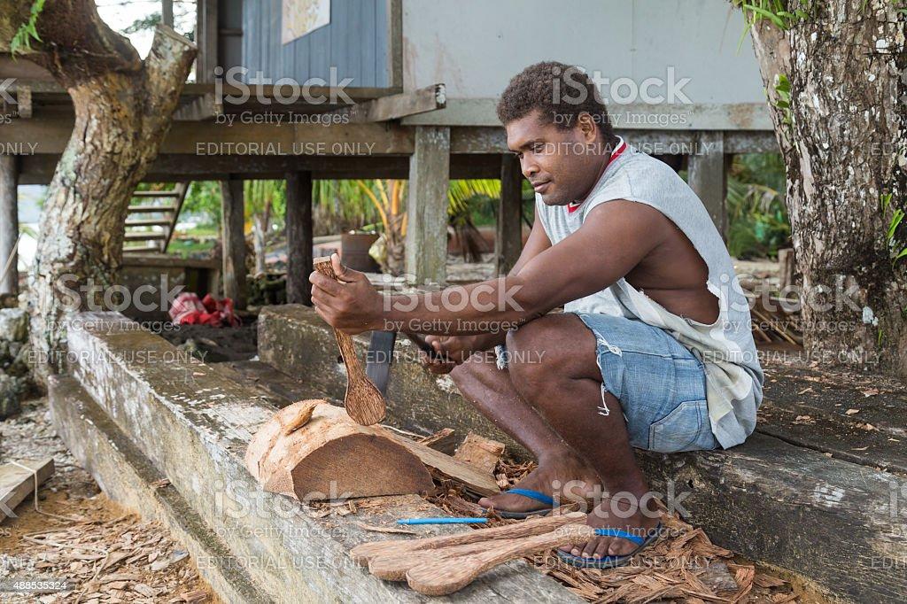 Man carving wood stock photo