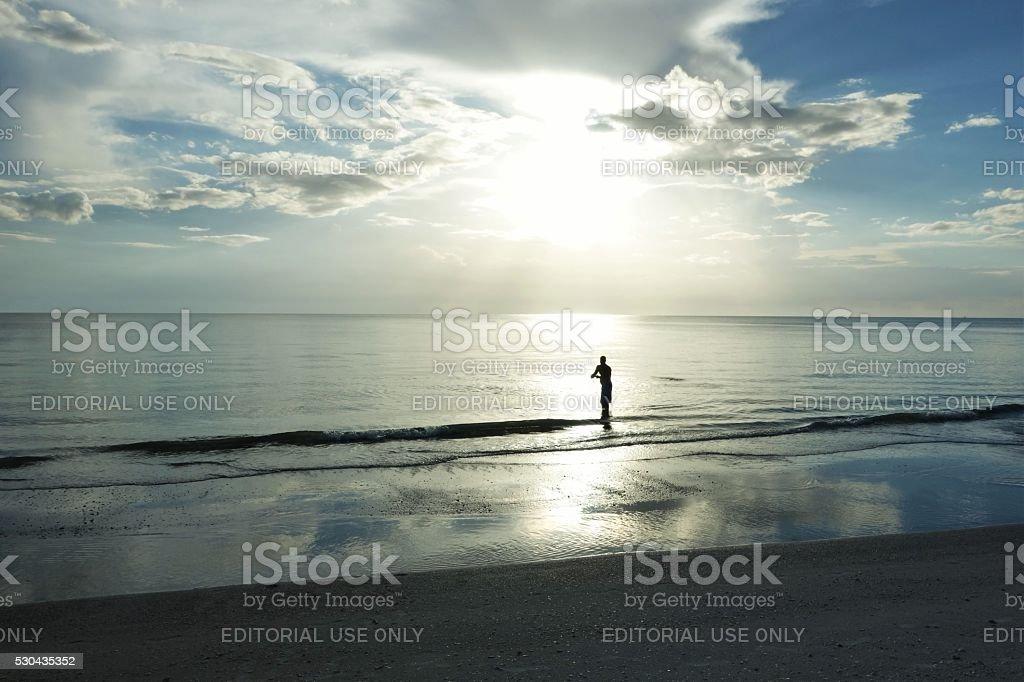 Man casting fishing net on Marco Island, Florida. stock photo