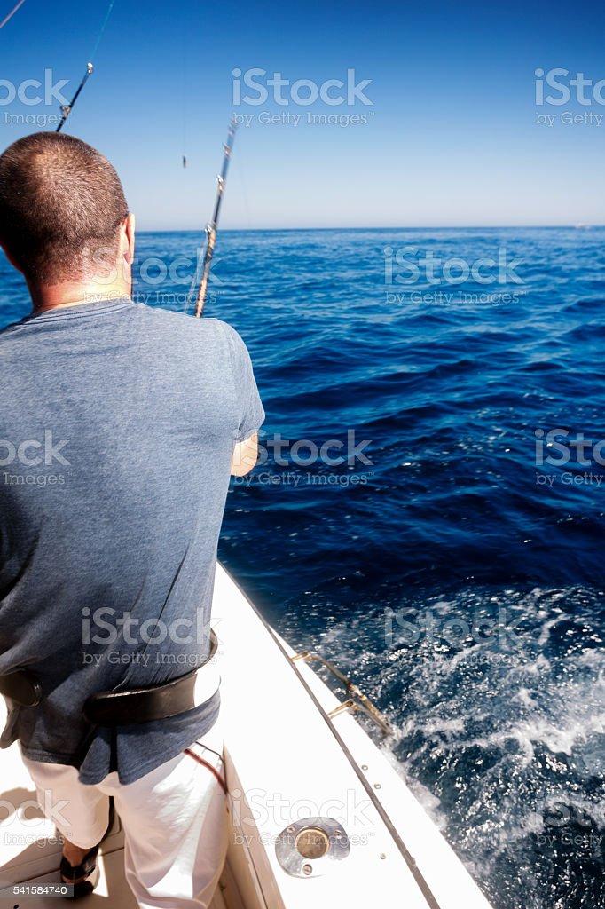 Man Catching Big Fish in Ocean stock photo