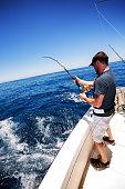 Man Catching Big Fish in Ocean