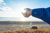 Man catching the sun