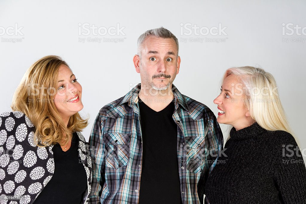 Man Caught Between Two Women, What Did He Do stock photo