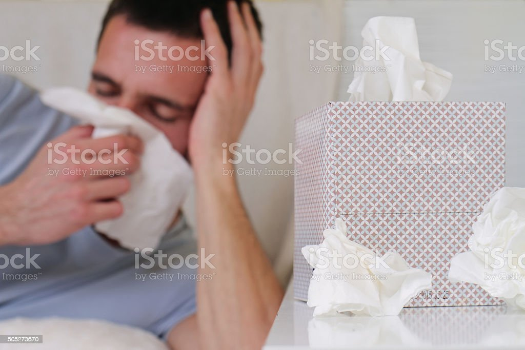 Man caught cold , flue, running nose stock photo
