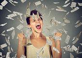 man celebrates success under money rain falling down dollars