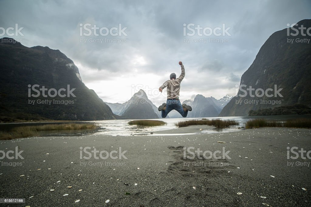 Man celebrates successful life stock photo