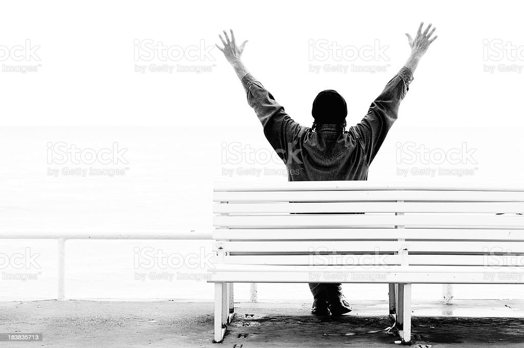 Man Celebrating Success by Sea.Black And White.Copy Space royalty-free stock photo