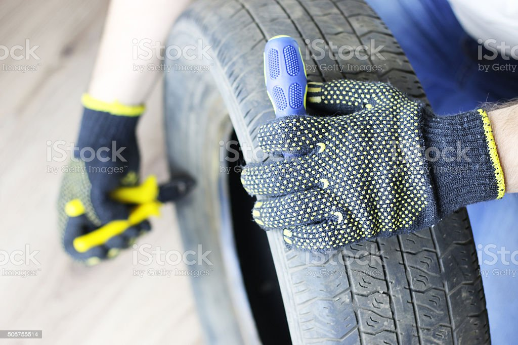man changing tire wheels winter stock photo