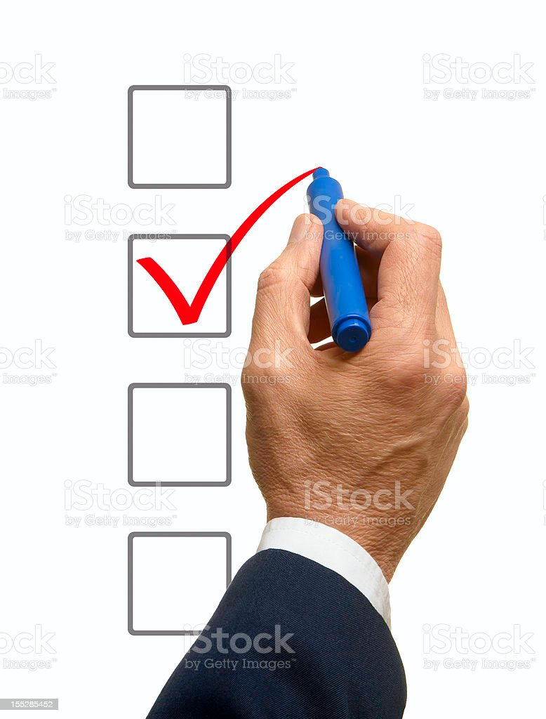 A man checking a box on a check list royalty-free stock photo