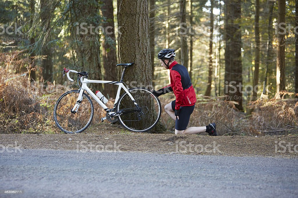 Man checking bicycle puncture stock photo