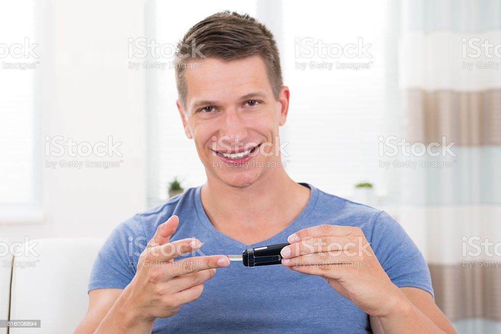 Man Checking Blood Sugar Level stock photo