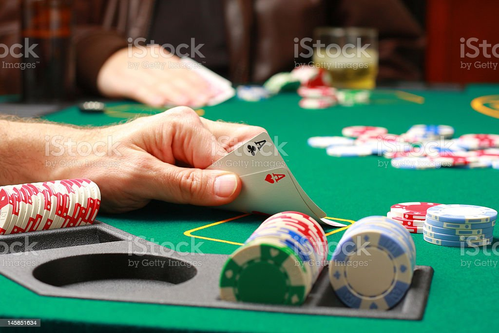 Man checking cards during poker game stock photo