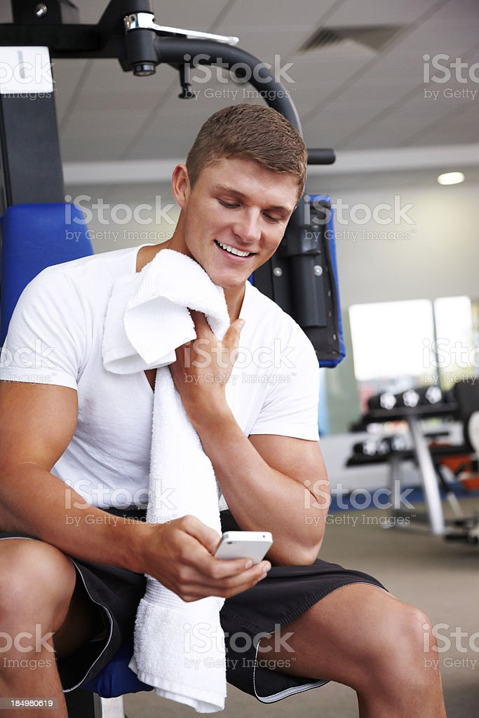 Man Checking His Cellphone at the Gym royalty-free stock photo