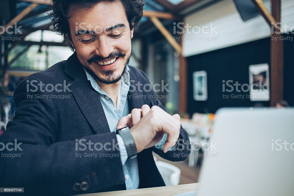 Man checking his smart watch stock photo