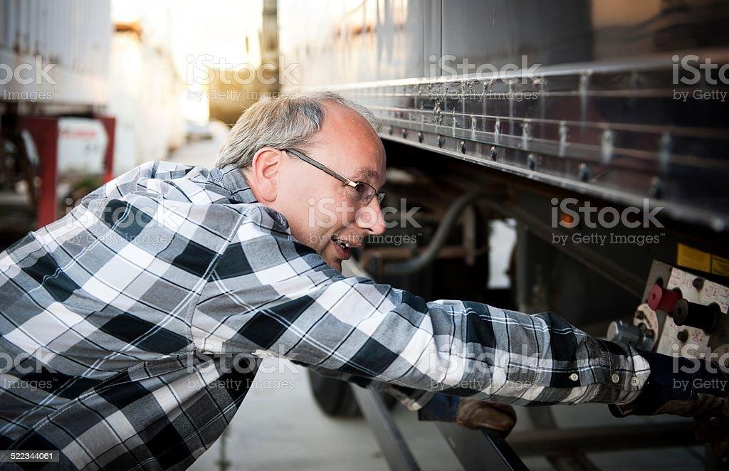 Man checking his truck stock photo