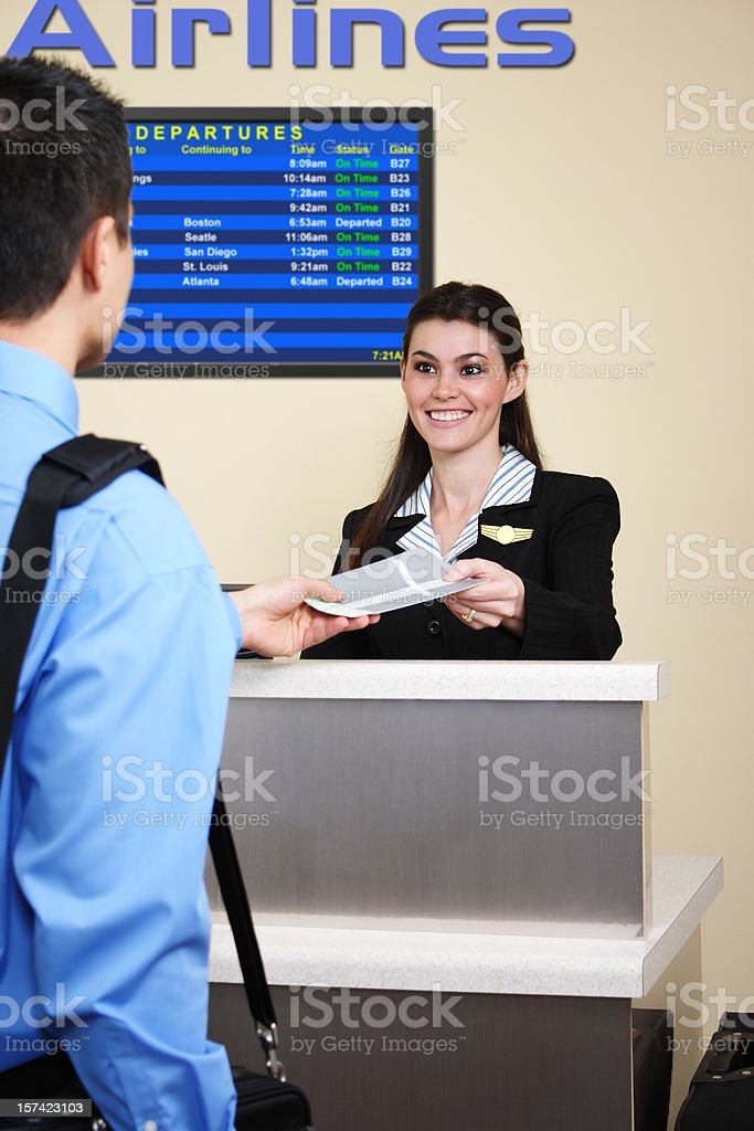 Man checking in at the airport stock photo