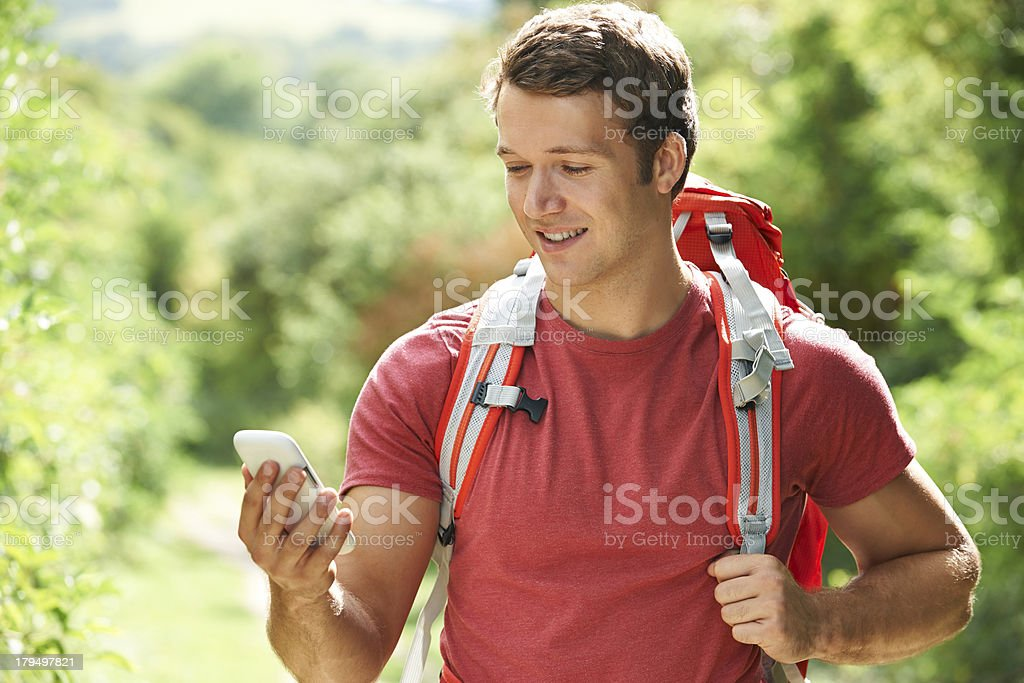 Man Checking Location With Mobile Phone On Hike royalty-free stock photo