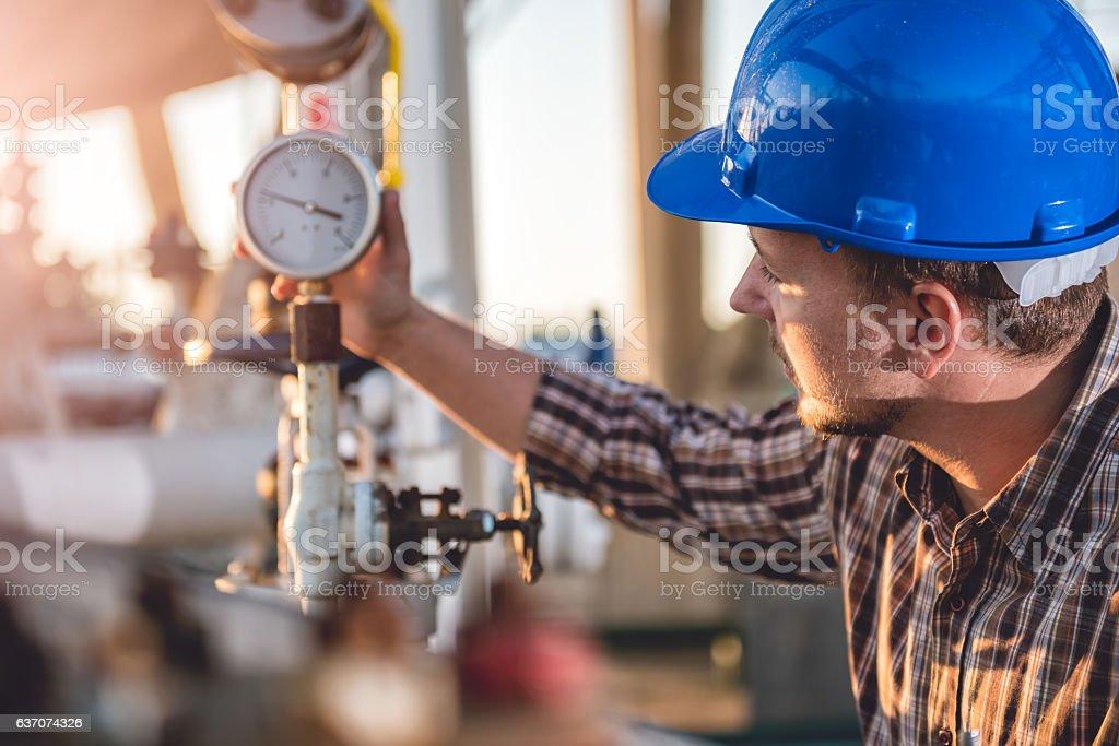 Man checking manometer stock photo
