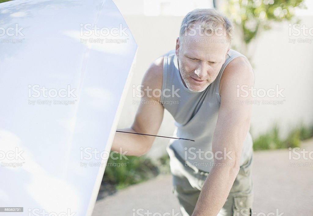 Man checking oil in car royalty-free stock photo