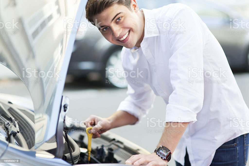 Man checking oil level in car royalty-free stock photo