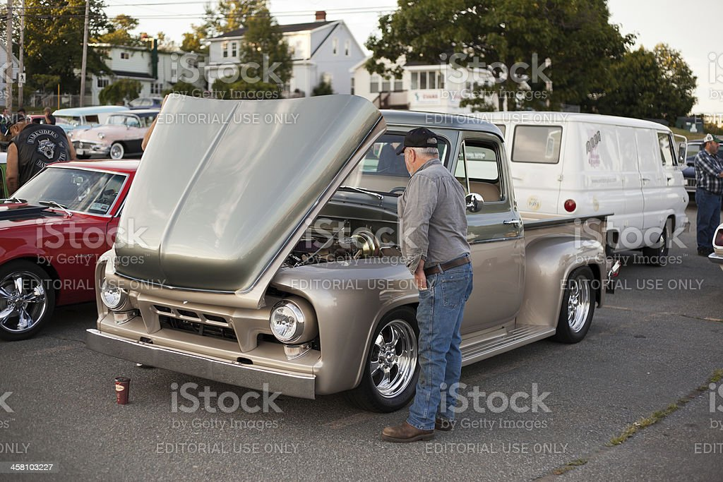 Man Checking Out Engine of Antique Truck stock photo