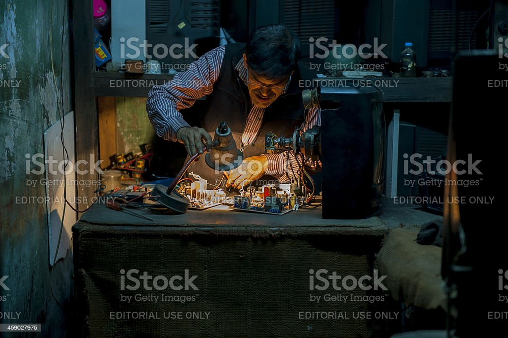 Man checking the circuit board workshop, Bangladesh stock photo
