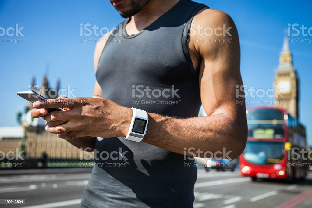 Man checking the time for a run in London stock photo