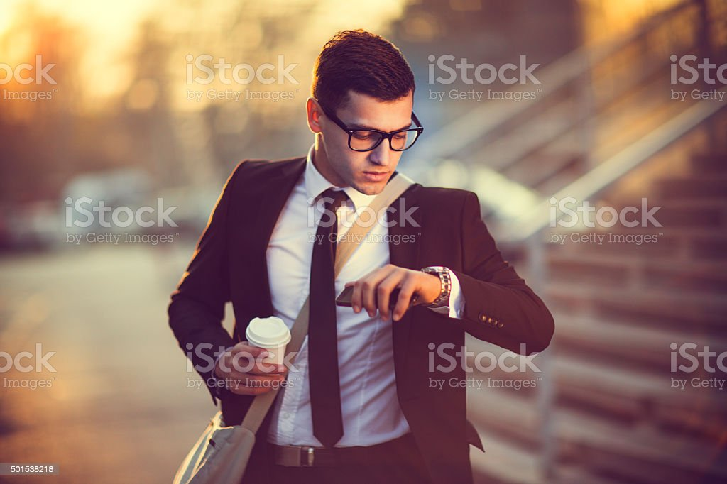 Man checking the time stock photo