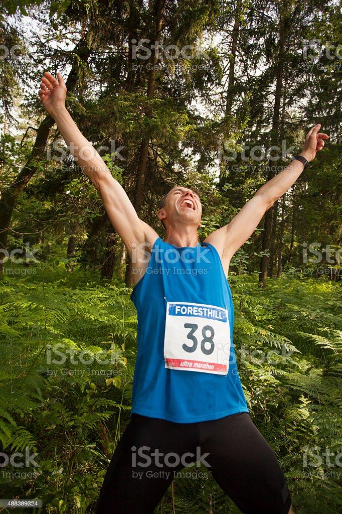 Man cheering during ultramarathon race stock photo
