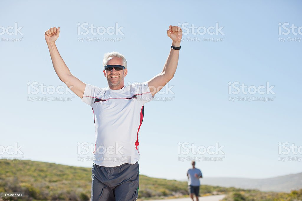 Man cheering on remote road royalty-free stock photo