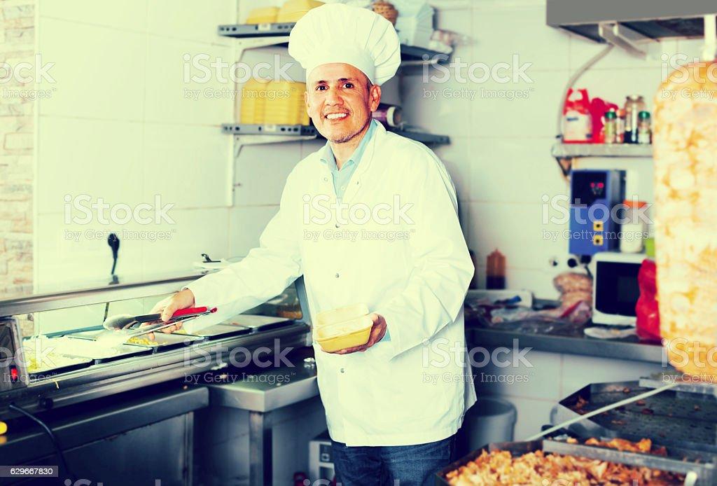 man chef serving fresh kebab stock photo