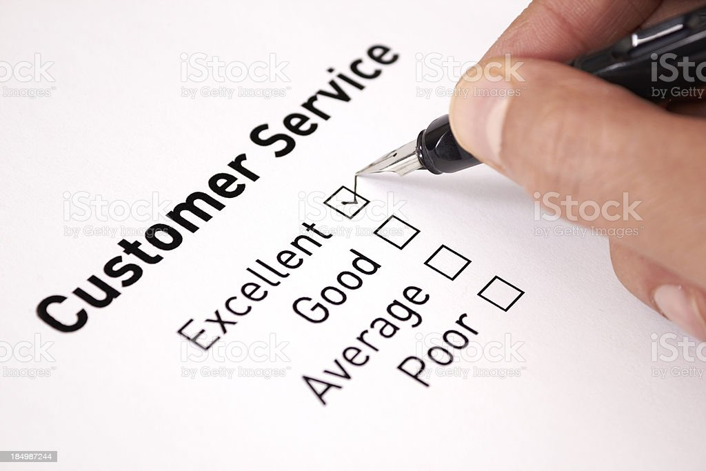 A man chooses excellent on a customer service survey stock photo