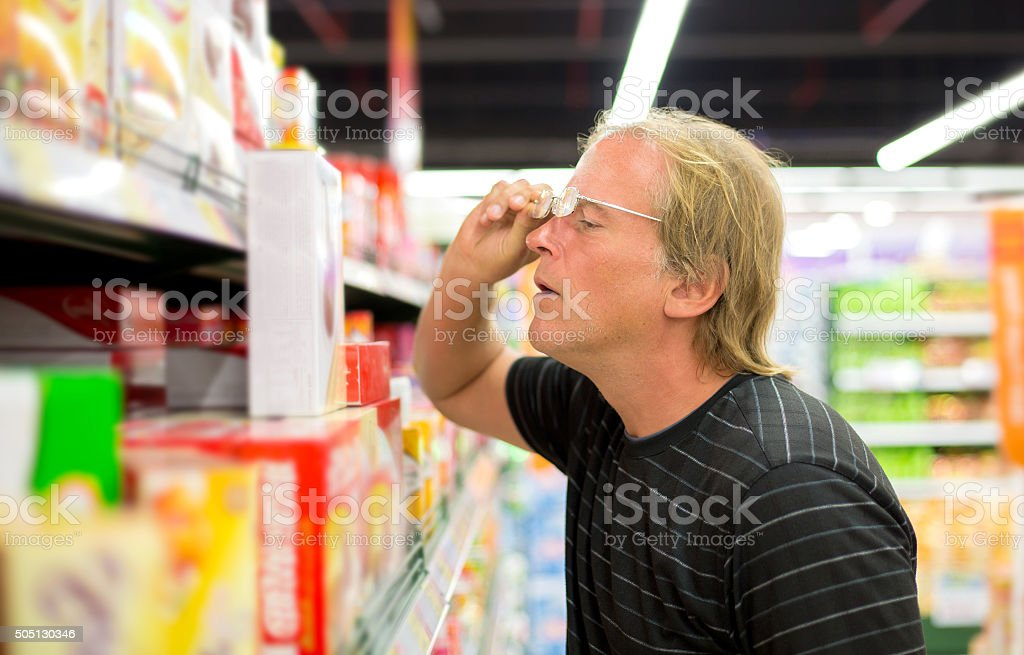 Man chooses products at the supermarket stock photo